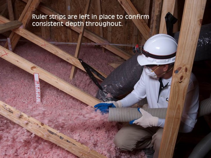 Ruler strips are left in place to confirm correct insulation coverage for your attic.