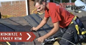 Roofing Contractor Works on a roof