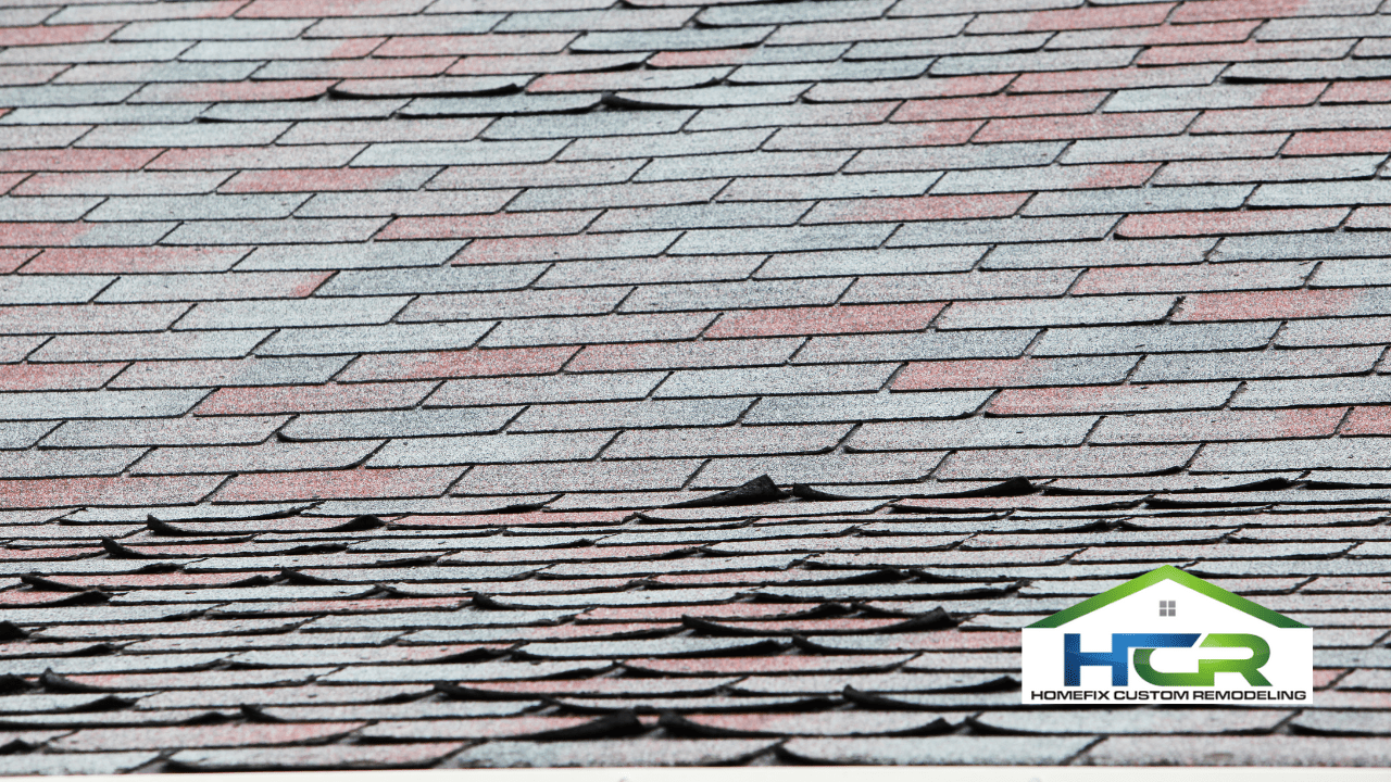 Picture of badly hail damaged roof and peeling shingles