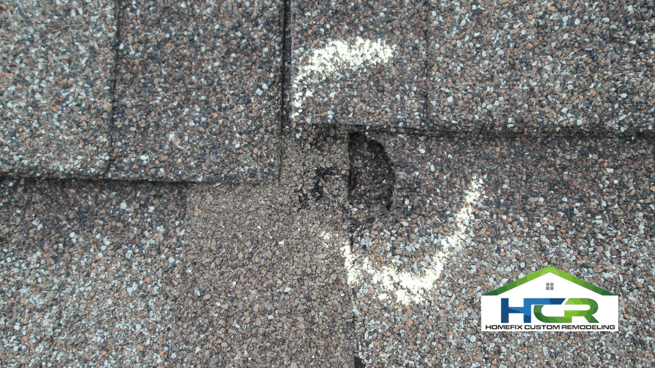 Image of a damaged roof from hail storm.